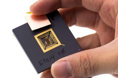 Yunsup Lee holding RISC V prototype chip. At UC Berkeley Par Lab Winter Retreat, January 2013.