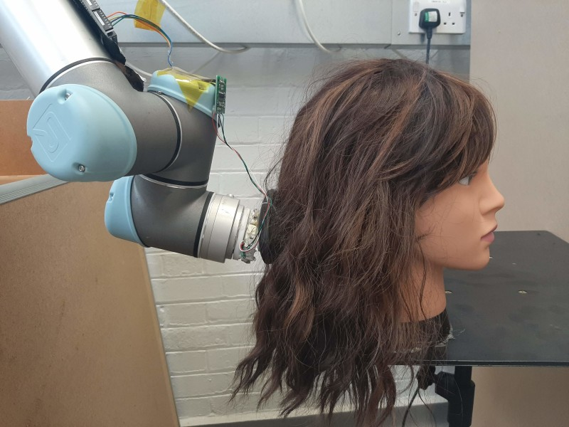 MIT's New Robot Brushes Your Hair