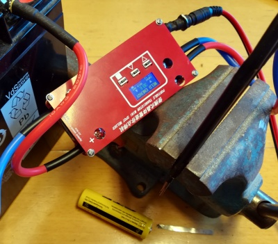 The mini spot welder set up to use, with electrodes held in a vice.