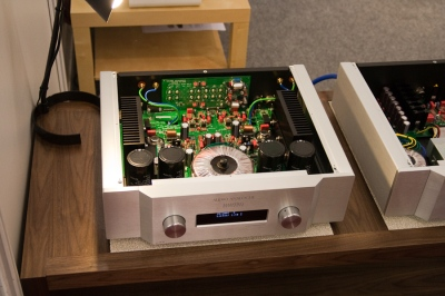 The power supply transformer anc capacitors at the front of this amplifier are the largest of its components. Christian Herzog, CC BY 2.0.