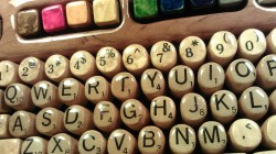 wooden keyboard with Scrabble tiles