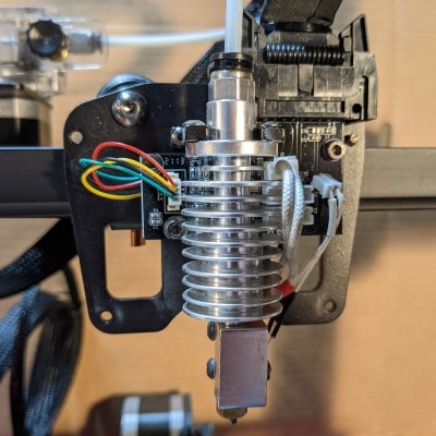Anycubic Vyper extruder with cover removed, showing the hot end.