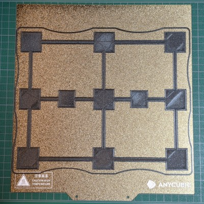 Single layer thick test pattern of 3x3 squares on a build plate. They look fine.