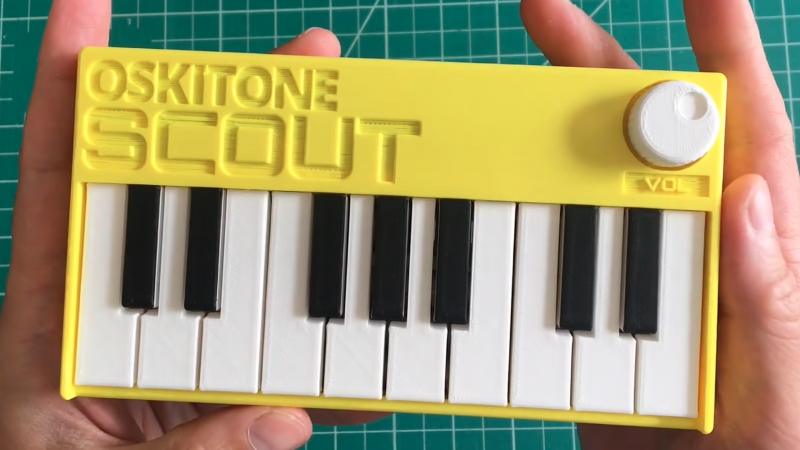 Small synth held in two hands