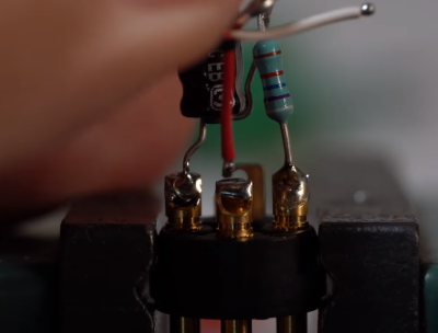 Soldering a 3.3uF capacitor and a 100k-ohm resistor inside each XLR plug.
