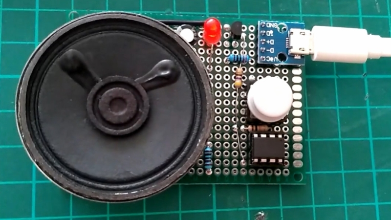 ATtiny85 on circuit board with 2n2222, pushbutton, usb-c power connector, LED, and speaker.