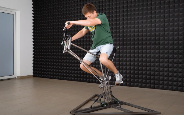 a man sits on top of a motorcycle simulation rig