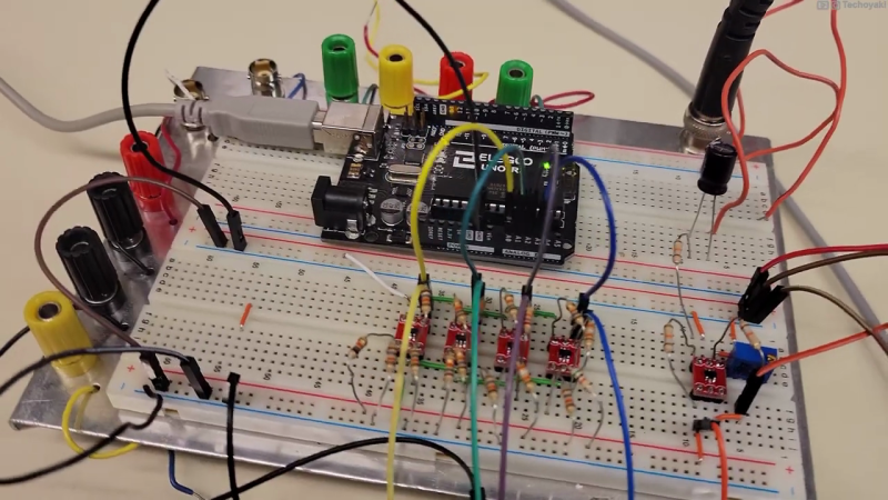 Photo of a prototyping breadboard with an Arduino, whose analog inputs are connected to an array of four small op-amp circuits which perform the voltage slicing function of the Quantizer circuit described in this article.