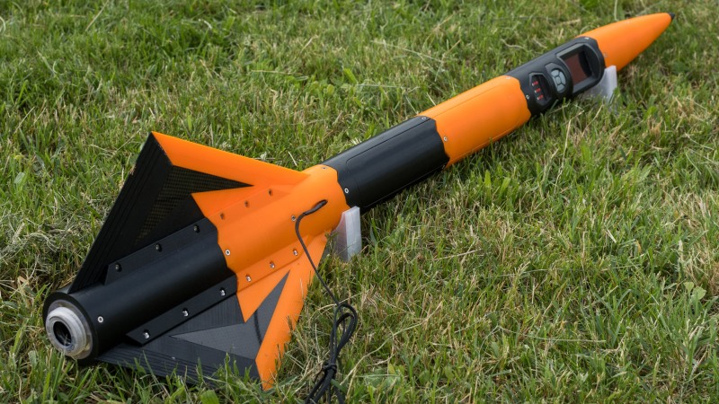 3D printed rocket laying on grass