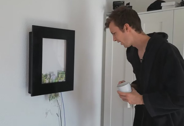 A man watching money being shredded in a picture frame