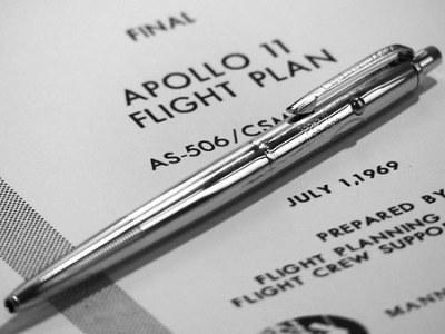 An original Fisher Space Pen AG-7 atop the Apollo 11 flight plan.