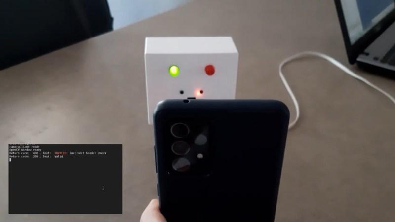 A Raspberry Pi-based COVID Green Pass validator verifies a QR code on a phone.