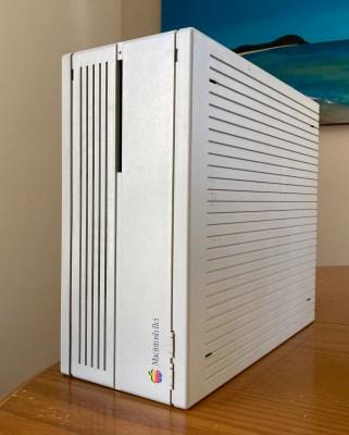 An Apple Macintosh IIci computer standing on its side