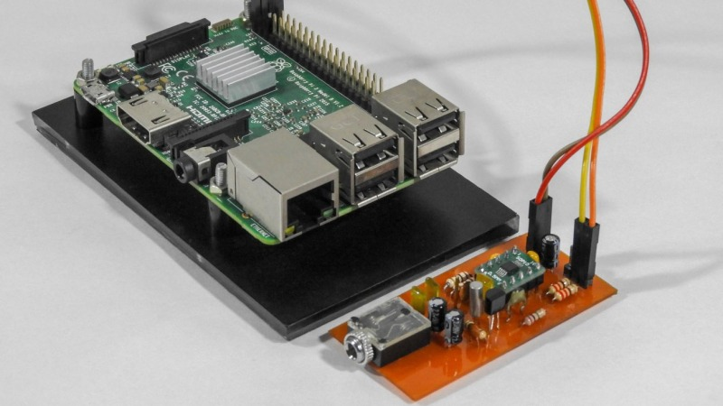 A Raspberry Pi next to a small circuit board