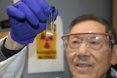 PNNL scientist holding up yellowcake recovered from seawater.