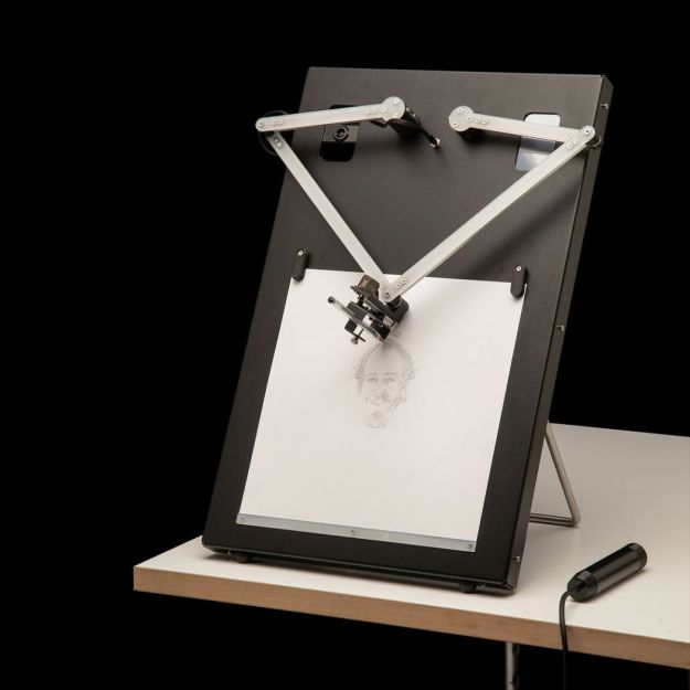 A portrait-drawing robot on a table